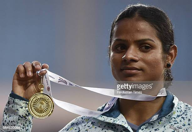 Dutee Chand of Odisha with Gold medal after winning Womens 100m event during the 20th Federation Cup senior National Athletis Champioonships at JN...