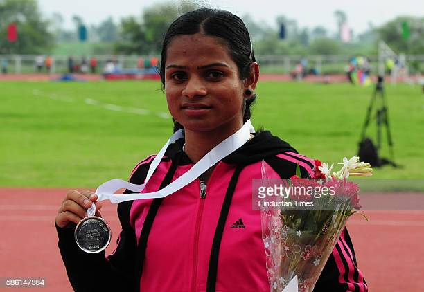 Dutee Chand showing her silver medal won in 100 metre race in the 81st All India Railway athletics championship at SAI centre Goragaon on August 6...