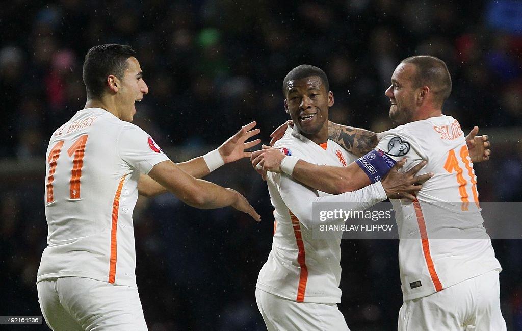 Duthch national team players Anwar El Ghazi Georginio Wijnaldum and Wesley Sneijder celebrate their goal during the Euro 2016 qualifying football...