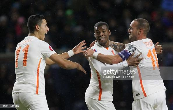 Duthch national team players Anwar El Ghazi Georginio Wijnaldum and Wesley Sneijder celebrate their goal during the Euro 2016 qualifying football...