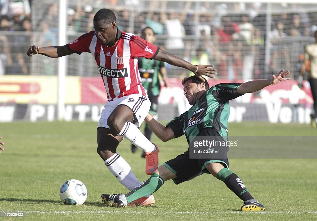 Duvan Zapata of Estudiantes de La Plata fights for the ball during a match between San Martin de San Juan and Estudiantes de La Plata as part of the Torneo Final 2013 at the Ingeniero Hilario Sanchez stadium on June 15 2013 in San Juan, Argentina.