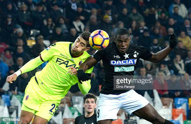 Duvan Zapata of Udinese Calcio battles for an aerial ball with Adam Masina of Bologna FC during the Serie A match between Udinese Calcio and Bologna...