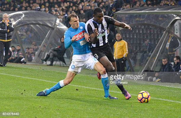 Duvan Zapata of Udinese Calcio competes with Elsejd Hysaj of SSC Napoli during the Serie A match between Udinese Calcio and SSC Napoli at Stadio...