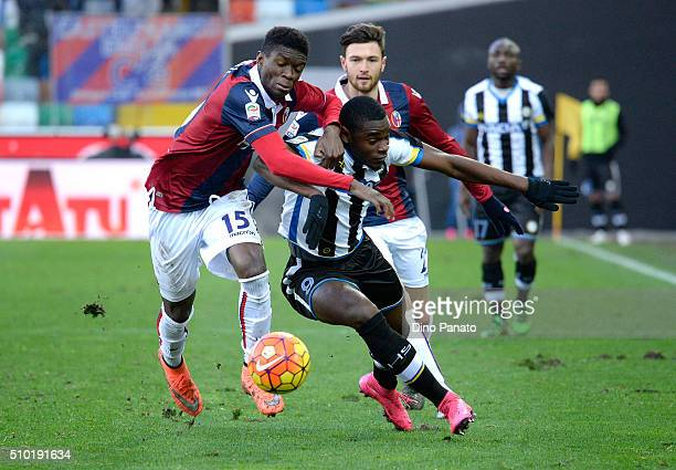 Duvan Zapata of Udinese Calcio competes with Ibrahima Mbaye of Bologna FC during the Serie A match between Udinese Calcio and Bologna FC at Stadio...