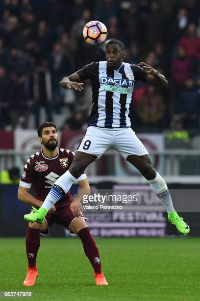 Duvan Zapata of Udinese Calcio goes up against Luca Rossettini of FC Torino during the Serie A match between FC Torino and Udinese Calcio at Stadio...