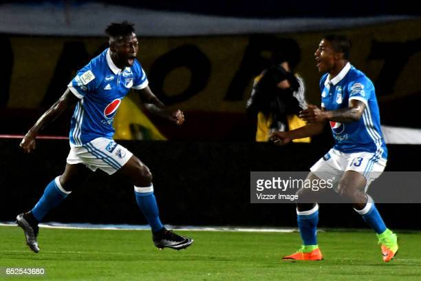 Duvier Riascos of Millonarios celebrates with teammate Harold Mosquera after scoring the first goal of his team during a match between Millonarios...