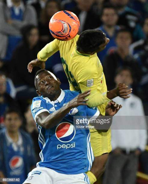 Duvier Riascos of Millonarios fights for the ball with Christian Mafla of Atletico Bucaramanga during the match between Millonarios and Atletico...
