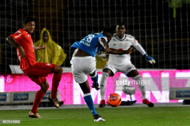 Duvier Riascos of Millonarios kicks the ball to score the first goal of his team during a match between Millonarios and America de Cali as part of...