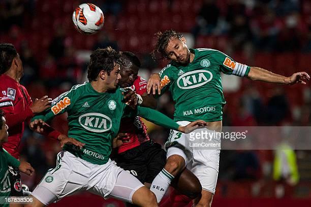 Duvier Riascos of Xolos de Tijuana fights for the ball with Henrique Buss of Palmeiras during a match between Xolos de Tijuana and Palmeiras as part...