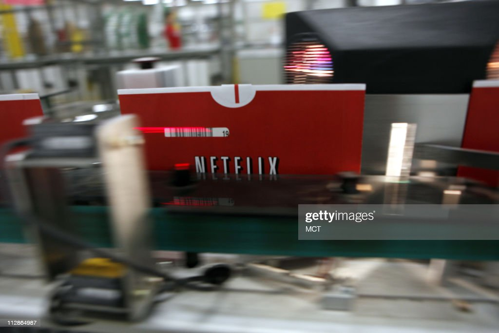 DVDs inside envelopes are scanned labeled and sorted by a modified USPS First Class Mail sorter May 13 at NetFlix's Carol Stream Illinois...