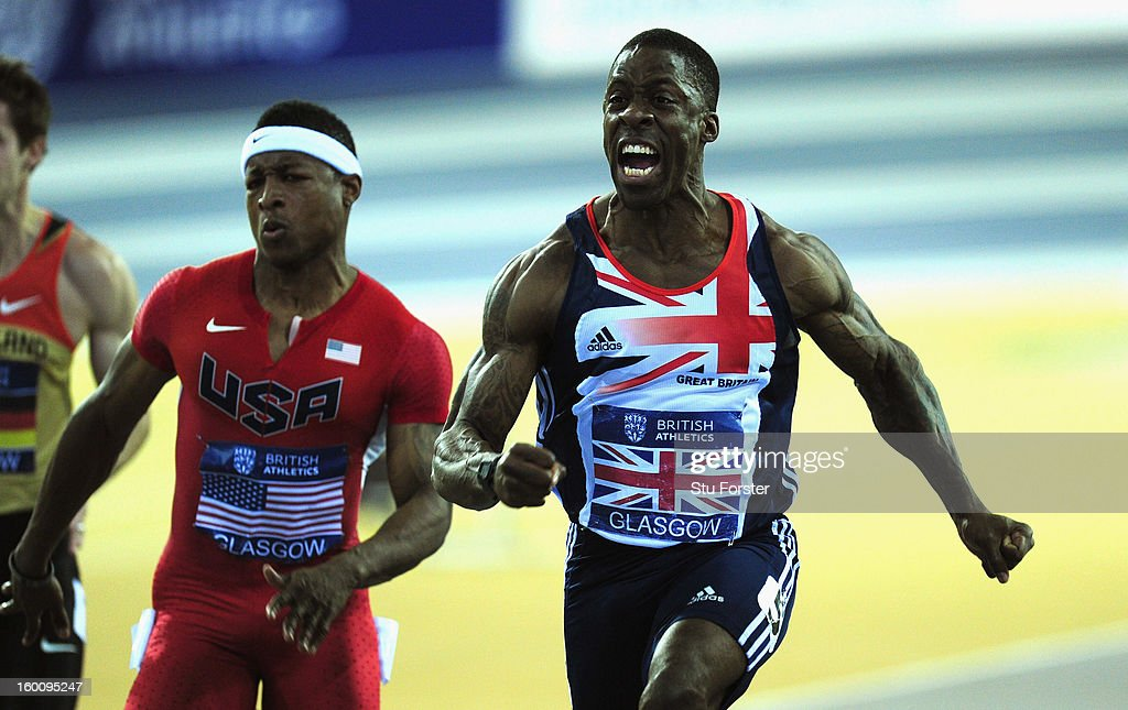 Dwain Chambers of Great Britain (r) celebrates after winning the Mens 60 metres beating Michael Rodgers of the USA (l) during the British Athletics International Match at the Emirates Arena on January 26, 2013 in Glasgow, Scotland.