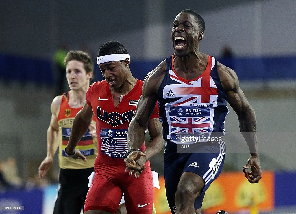 Dwain Chambers (R) of Great Britain crosses the finish line to win the Men's 60m during The British Athletics Glasgow International Match at The Emirates Arena, Glasgow, Scotland, on January 26, 2013. AFP PHOTO / Ian MACNICOL