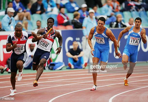 Dwain Chambers of Great Britain hands the baton to team mate Darren Campbell as Stefano Anceschi of Italy passes to Luca Verdecchia during the Men's...