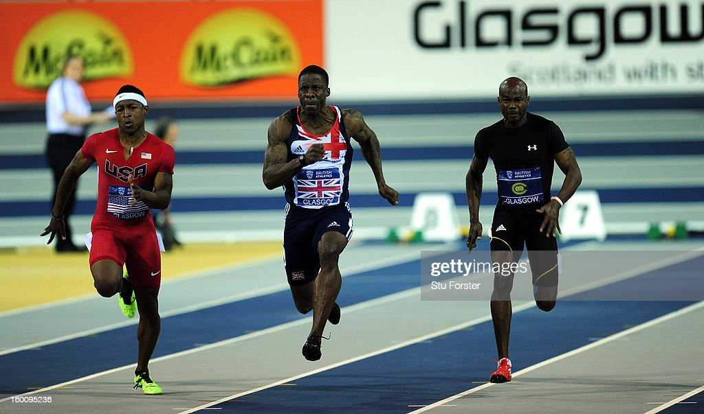 Dwain Chambers of Great Britain (c) on his way to winning the Mens 60 metres beating Michael Rodgers of the USA (l) and Kim Collins of the Commonwealth Select team during the British Athletics International Match at the Emirates Arena on January 26, 2013 in Glasgow, Scotland.