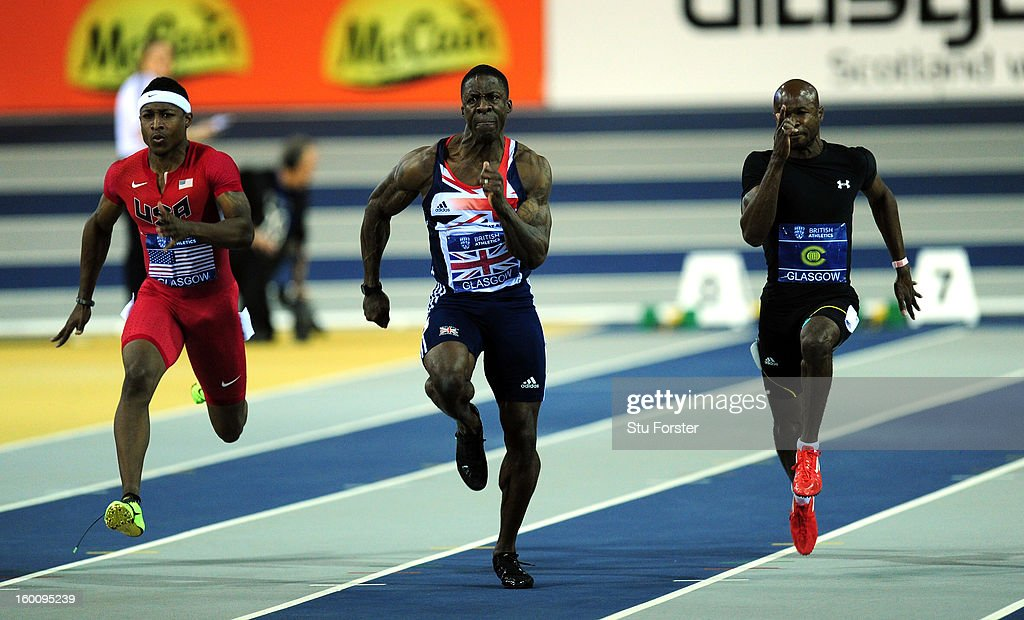 <a gi-track='captionPersonalityLinkClicked' href=/galleries/search?phrase=Dwain+Chambers&family=editorial&specificpeople=215102 ng-click='$event.stopPropagation()'>Dwain Chambers</a> of Great Britain (c) on his way to winning the Mens 60 metres beating Michael Rodgers of the USA (l) and <a gi-track='captionPersonalityLinkClicked' href=/galleries/search?phrase=Kim+Collins+-+Sprinter&family=editorial&specificpeople=171583 ng-click='$event.stopPropagation()'>Kim Collins</a> of the Commonwealth Select team during the British Athletics International Match at the Emirates Arena on January 26, 2013 in Glasgow, Scotland.