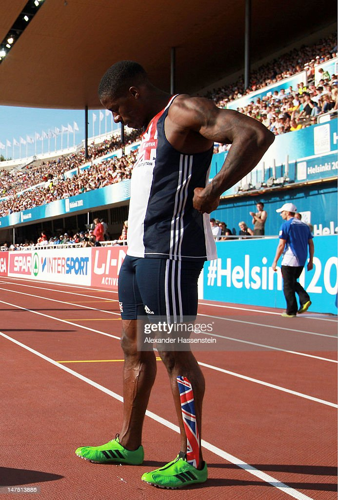 <a gi-track='captionPersonalityLinkClicked' href=/galleries/search?phrase=Dwain+Chambers&family=editorial&specificpeople=215102 ng-click='$event.stopPropagation()'>Dwain Chambers</a> of Great Britain reacts after dropping the baton in the Men's 4x100 Metres Final during day five of the 21st European Athletics Championships at the Olympic Stadium on July 1, 2012 in Helsinki, Finland.