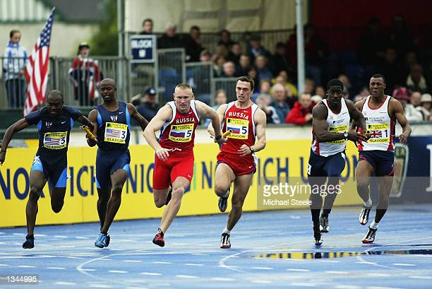 Dwain Chambers of Great Britain takes the baton for the final leg of the Mens 4x100 metres relay at the UK Athletics and Norwich Union Challenge at...