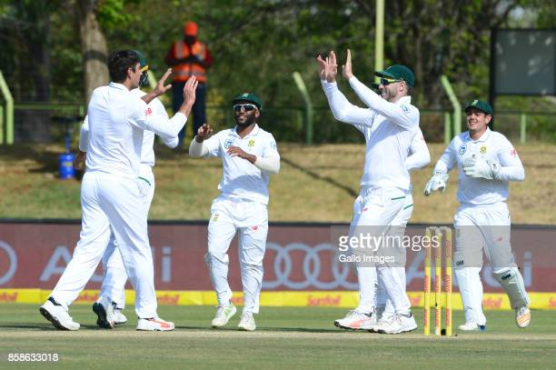 Dwaine Pretorius and Faf du Plessis of the Proteas celebrate the wicket of Mominul Haque of Bangladesh during day 2 of the 2nd Sunfoil Test match...