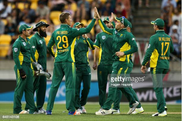 Dwaine Pretorius of South Africa celebrates with David Miller after taking the wicket of Mitchell Santner of New Zealand during game three of the One...