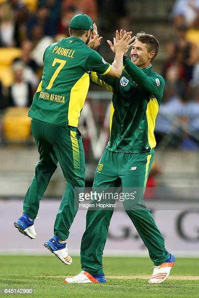Dwaine Pretorius of South Africa celebrates with Wayne Parnell after taking the wicket of Mitchell Santner of New Zealand during game three of the...