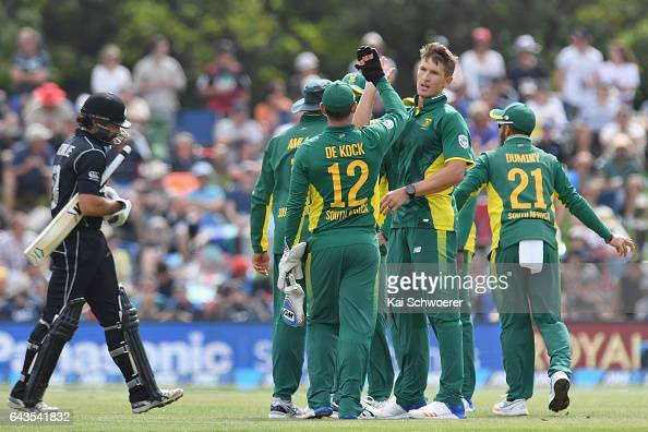 Dwaine Pretorius of South Africa is congratulated by team mates after dismissing Dean Brownlie of New Zealand during game two of the One Day...