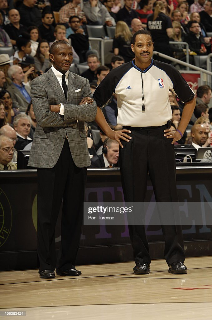 Dwane Casey of the Toronto Raptors chats with an official during the game Dallas Mavericks on December 14, 2012 at the Air Canada Centre in Toronto, Ontario, Canada.