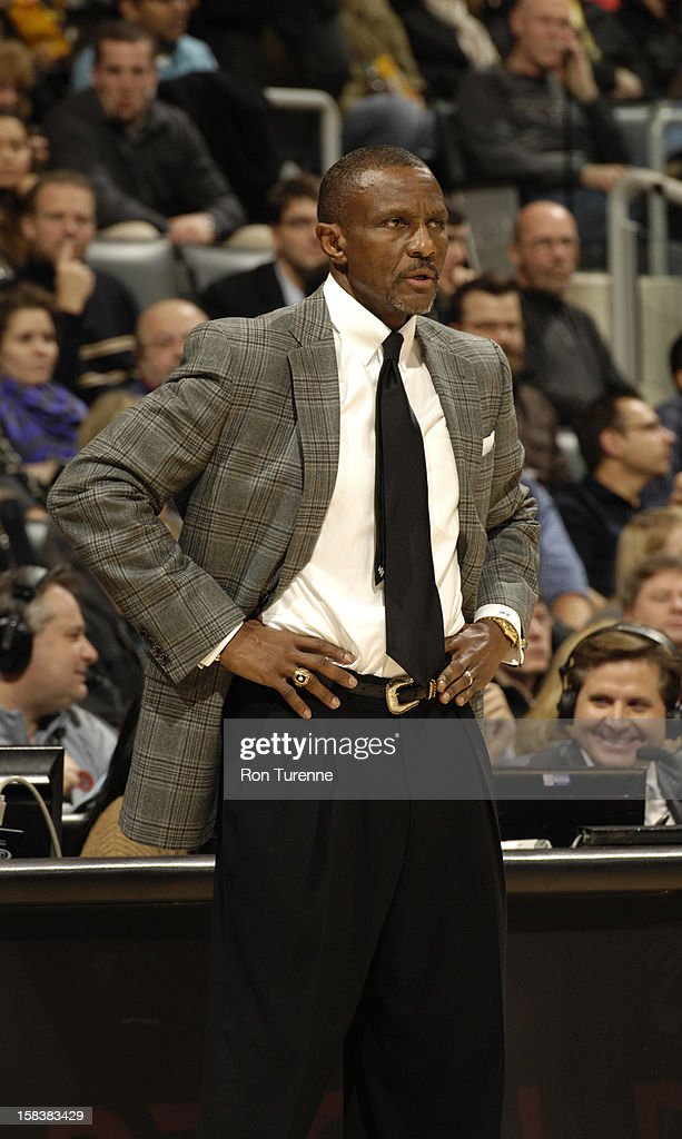 Dwane Casey of the Toronto Raptors looks on as his team plays against the Dallas Mavericks on December 14, 2012 at the Air Canada Centre in Toronto, Ontario, Canada.