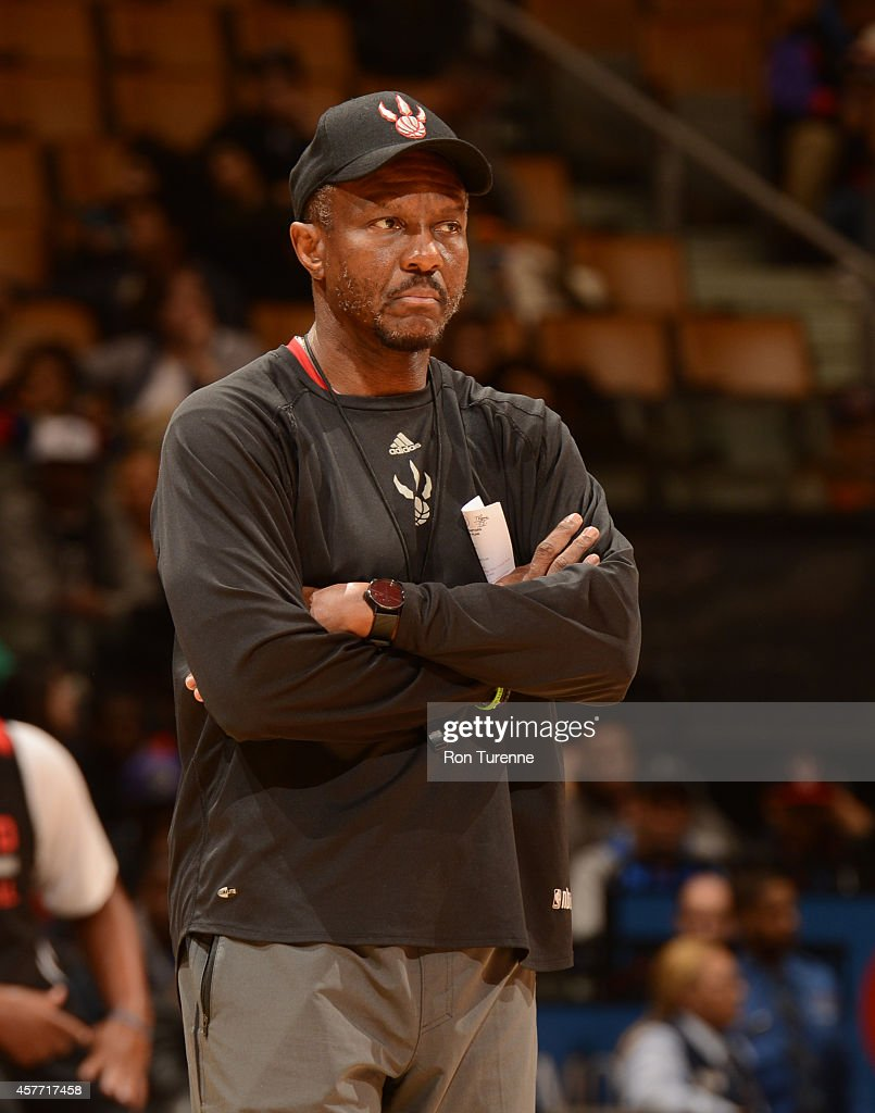 Dwane Casey of the Toronto Raptors looks on during open practice on October 19 2014 at the Air Canada Centre in Toronto Ontario Canada NOTE TO USER...