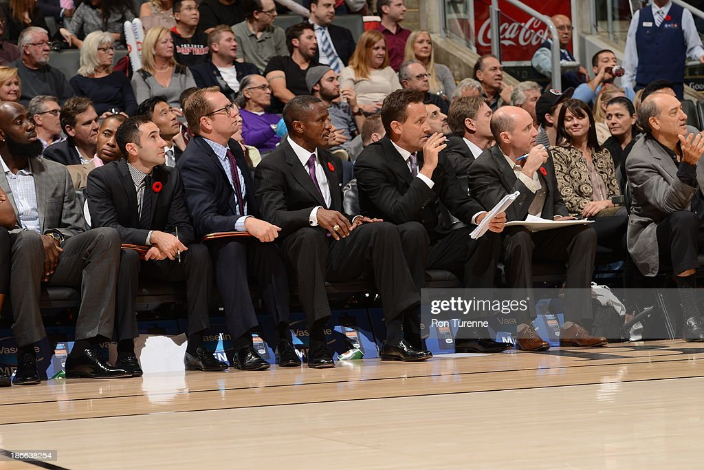 Dwane Casey of the Toronto Raptors sits on the bench against the Boston Celtics on October 23, 2013 at the Air Canada Centre in Toronto, Ontario, Canada.