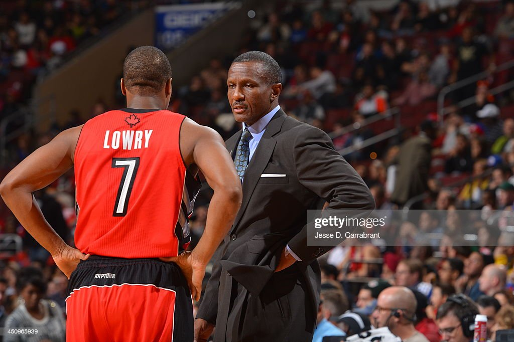 Dwane Casey of the Toronto Raptors speaks with Kyle Lowry during the game against the Philadelphia 76ers at the Wells Fargo Center on November 20...