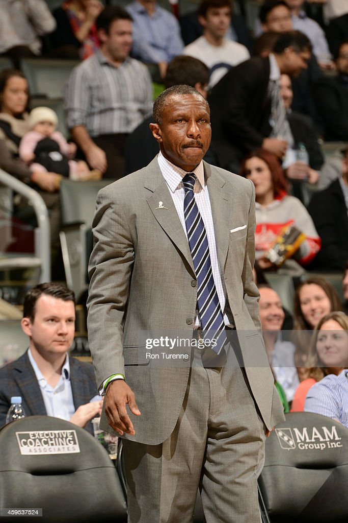 Dwane Casey of the Toronto Raptors stands on the court during a game against the Phoenix Suns on November 24 2014 at the Air Canada Centre in Toronto...