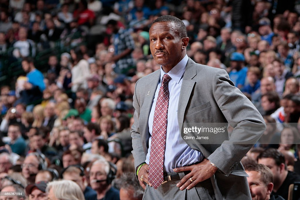 Dwane Casey of the Toronto Raptors stands on the court during a game against the Dallas Mavericks on February 24 2015 at the American Airlines Center...