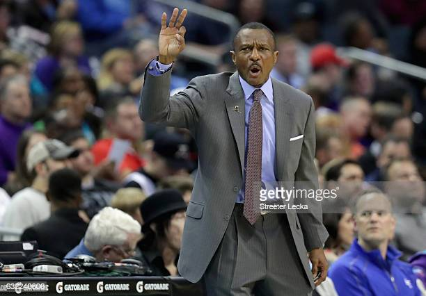 Dwane Casey of the Toronto Raptors yells to his team during their game against the Charlotte Hornets at Spectrum Center on January 20 2017 in...