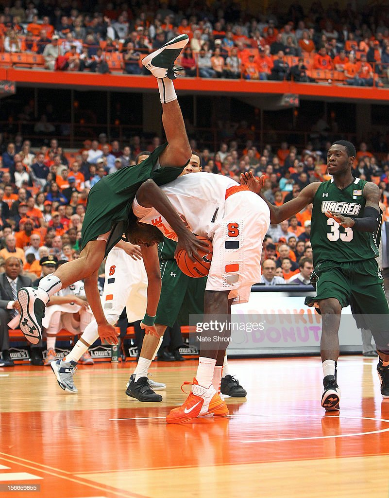 Dwaun Anderson #22 of the Wagner Seahawks flips over Baye Moussa Keita #12 of the Syracuse Orange as he drives to the basket during the game at the Carrier Dome on November 18, 2012 in Syracuse, New York.