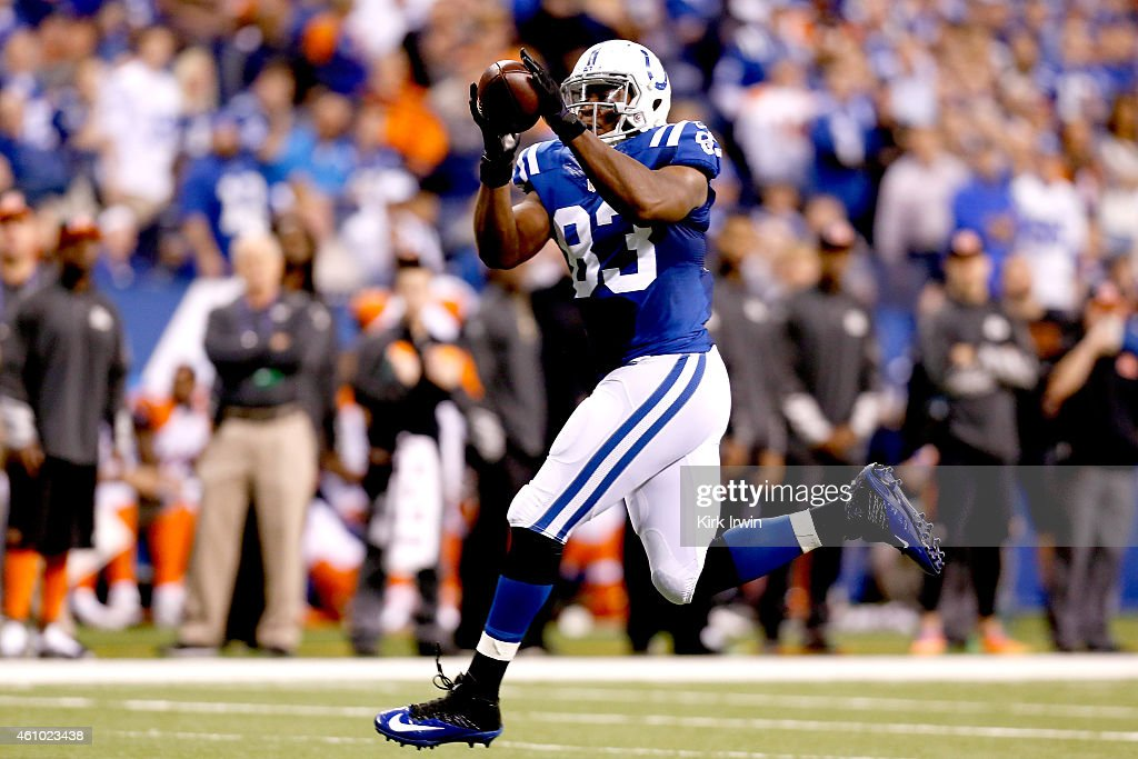 <a gi-track='captionPersonalityLinkClicked' href=/galleries/search?phrase=Dwayne+Allen&family=editorial&specificpeople=5292364 ng-click='$event.stopPropagation()'>Dwayne Allen</a> #83 of the Indianapolis Colts catches a pass against the Cincinnati Bengals in the first half during their AFC Wild Card game at Lucas Oil Stadium on January 4, 2015 in Indianapolis, Indiana.