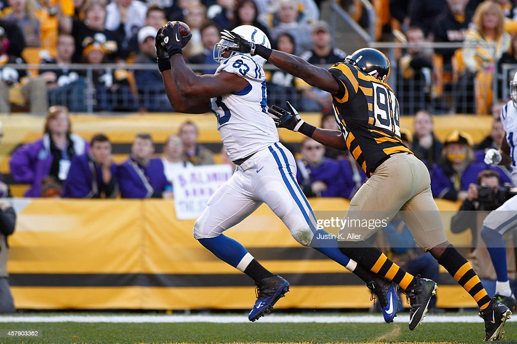<a gi-track='captionPersonalityLinkClicked' href=/galleries/search?phrase=Dwayne+Allen&family=editorial&specificpeople=5292364 ng-click='$event.stopPropagation()'>Dwayne Allen</a> #83 of the Indianapolis Colts catches a touchdown pass in front of <a gi-track='captionPersonalityLinkClicked' href=/galleries/search?phrase=Lawrence+Timmons&family=editorial&specificpeople=2138080 ng-click='$event.stopPropagation()'>Lawrence Timmons</a> #94 of the Pittsburgh Steelers during the second quarter at Heinz Field on October 26, 2014 in Pittsburgh, Pennsylvania.
