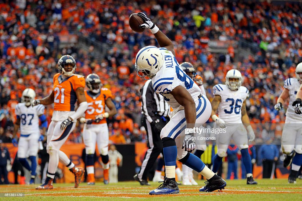 <a gi-track='captionPersonalityLinkClicked' href=/galleries/search?phrase=Dwayne+Allen&family=editorial&specificpeople=5292364 ng-click='$event.stopPropagation()'>Dwayne Allen</a> #83 of the Indianapolis Colts celebrates a second quarter touchdown against the Denver Broncos during a 2015 AFC Divisional Playoff game at Sports Authority Field at Mile High on January 11, 2015 in Denver, Colorado.