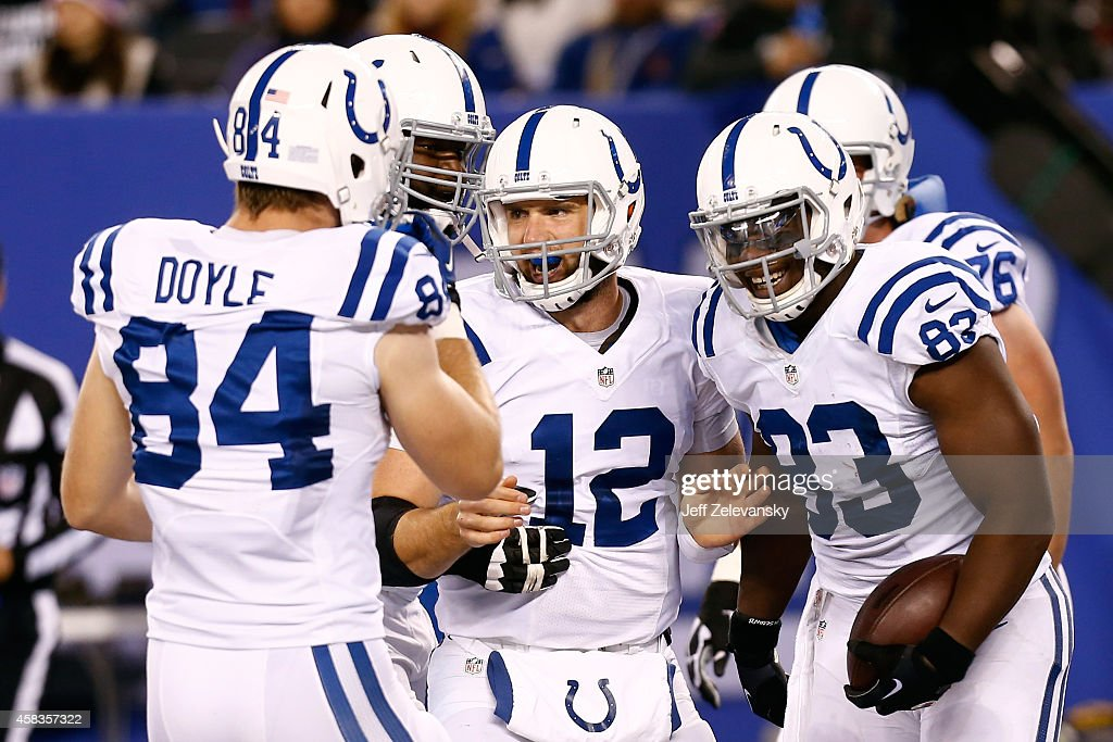 Dwayne Allen of the Indianapolis Colts celebrates with Andrew Luck after catching a 2 yard pass in the third quarter against the New York Giants...