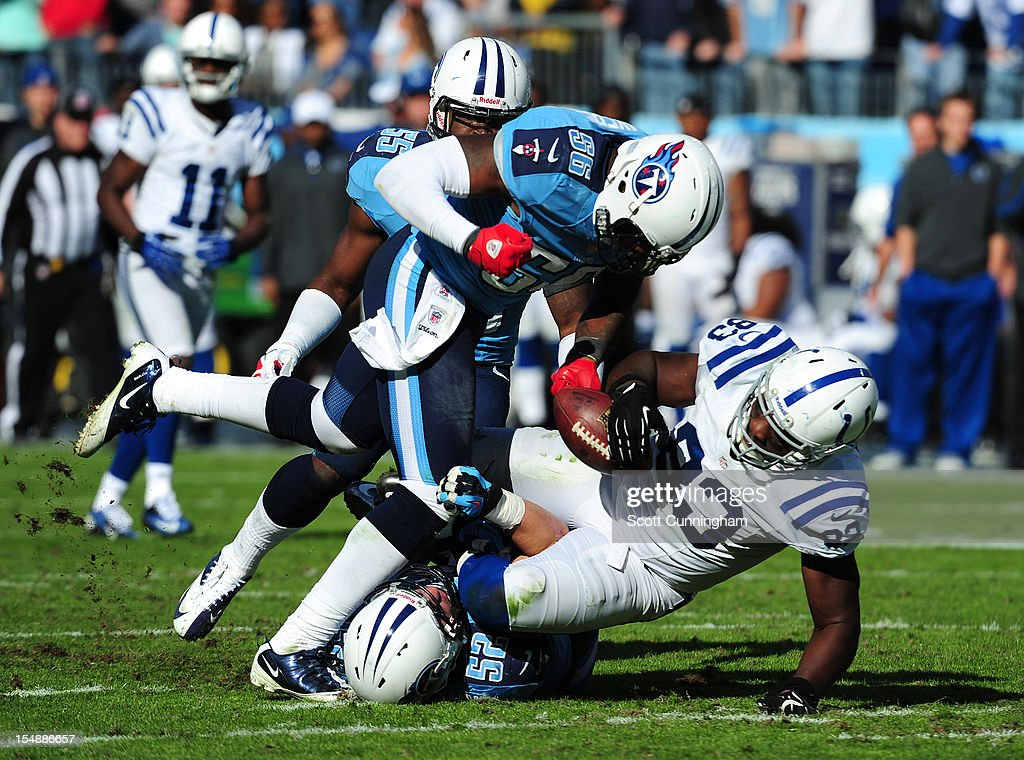 <a gi-track='captionPersonalityLinkClicked' href=/galleries/search?phrase=Dwayne+Allen&family=editorial&specificpeople=5292364 ng-click='$event.stopPropagation()'>Dwayne Allen</a> #83 of the Indianapolis Colts is tackled by Colin McCarthy #52 and <a gi-track='captionPersonalityLinkClicked' href=/galleries/search?phrase=Akeem+Ayers&family=editorial&specificpeople=5543453 ng-click='$event.stopPropagation()'>Akeem Ayers</a> #56 of the Tennessee Titans at LP Field on October 28, 2012 in Nashville, Tennessee.