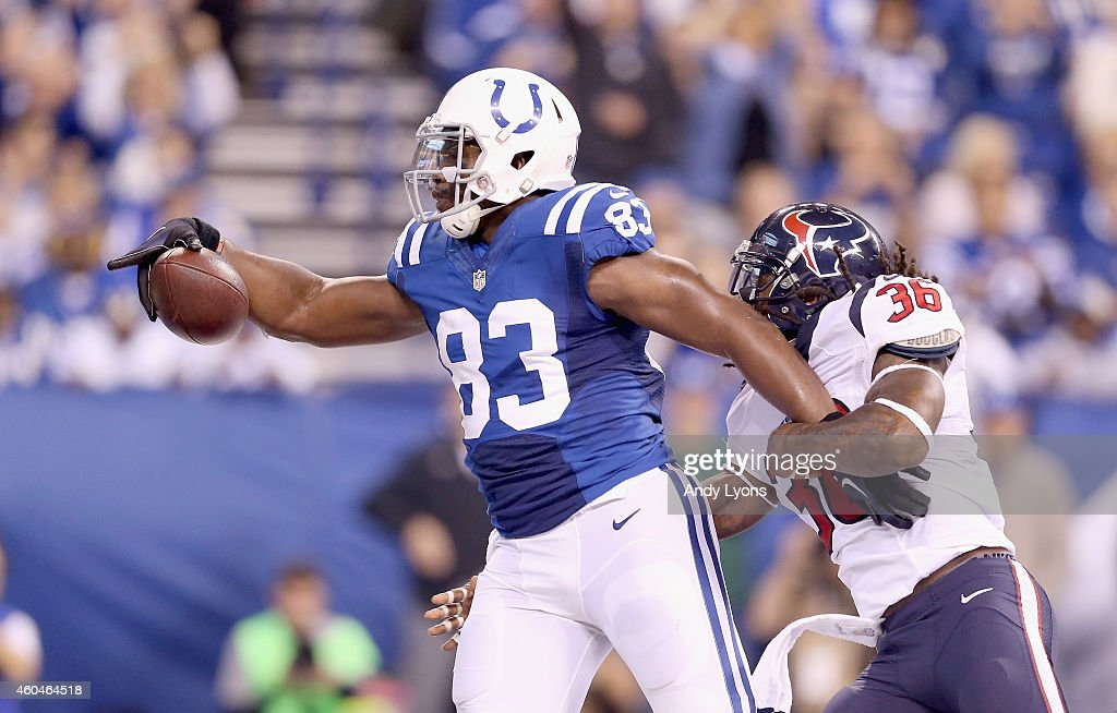 Dwayne Allen #83 of the Indianapolis Colts runs for a touchdown during the game against the Houston Texans at Lucas Oil Stadium on December 14, 2014 in Indianapolis, Indiana.