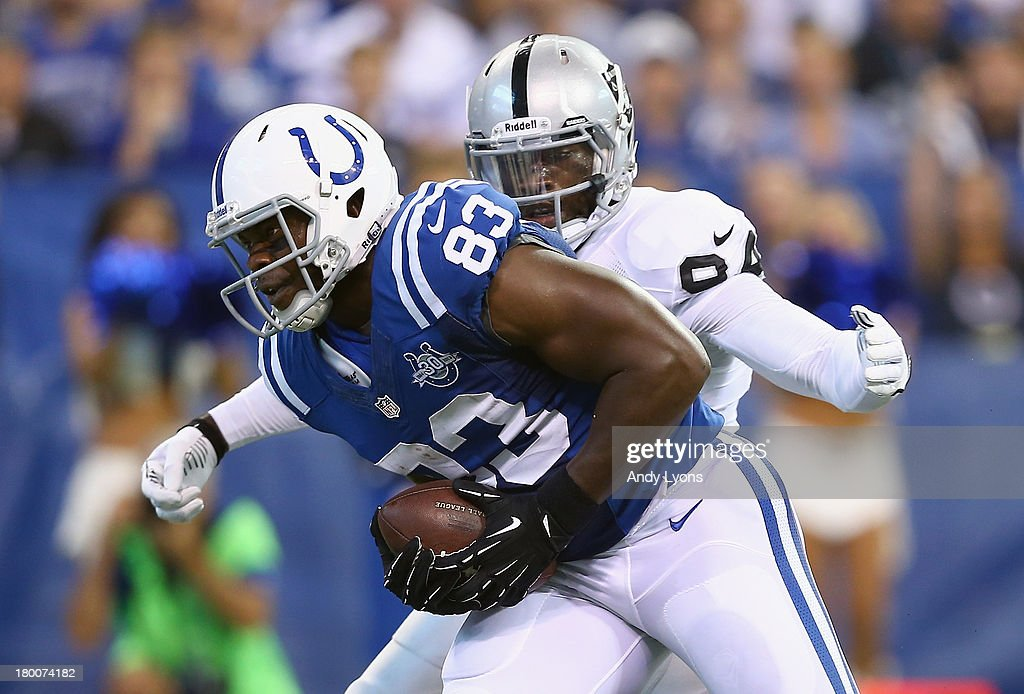 <a gi-track='captionPersonalityLinkClicked' href=/galleries/search?phrase=Dwayne+Allen&family=editorial&specificpeople=5292364 ng-click='$event.stopPropagation()'>Dwayne Allen</a> #83 of the Indianapolis Colts runs for a touchdown while defended by Kevin Burnett #94 of the Oakland Raiders during the Colts 21-17 win at Lucas Oil Stadium on September 8, 2013 in Indianapolis, Indiana.
