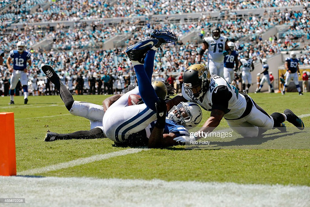 Dwayne Allen #83 of the Indianapolis Colts scores a touchdown on a pass from Andrew Luck #12 during the second quarter of the game against the Jacksonville Jaguars at EverBank Field on September 21, 2014 in Jacksonville, Florida.