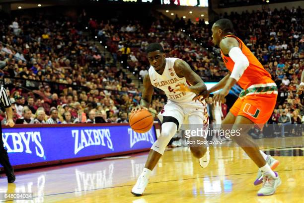 Dwayne Bacon guard Florida State University Seminoles looks for a lane to the basket against the Miami Hurricanes in an Atlantic Coast Conference...