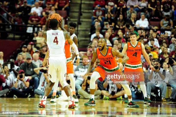 Dwayne Bacon guard Florida State University Seminoles shoots a threepointer over the Miami Hurricanes in an Atlantic Coast Conference game Saturday...