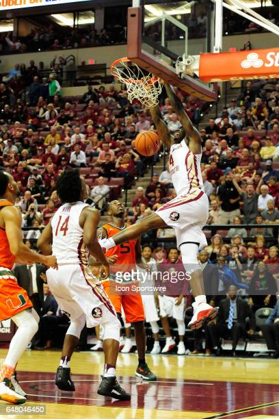 Dwayne Bacon guard Florida State University Seminoles slams home two of his game high 23 points against the Miami Hurricanes in an Atlantic Coast...