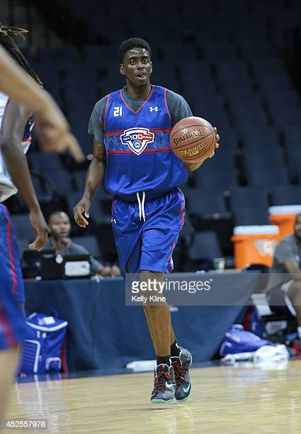Dwayne Bacon in blue brings the ball up the court during the National Basketball Players Association Top 100 Camp on June 18 2014 at John Paul Jones...