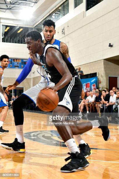 Dwayne Bacon of the Charlotte Hornets drives to the basket during the game against the Detroit Pistons during the 2017 Orlando Summer League on July...