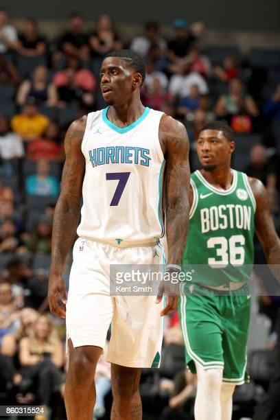 Dwayne Bacon of the Charlotte Hornets looks on during the game against the Boston Celtics on October 11 2017 at Spectrum Center in Charlotte North...