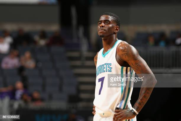 Dwayne Bacon of the Charlotte Hornets looks on during the game against the Dallas Mavericks on October 13 2017 at Spectrum Center in Charlotte North...