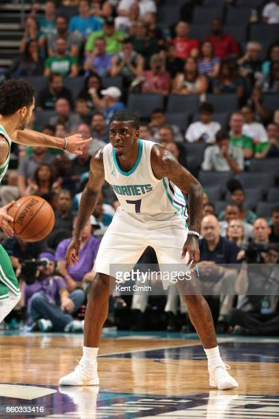 Dwayne Bacon of the Charlotte Hornets plays defense against the Boston Celtics on October 11 2017 at Spectrum Center in Charlotte North Carolina NOTE...
